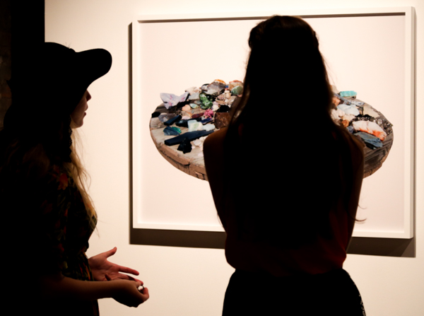 Gallery attendees consider one of Given's works. Photo by Jay Bowman.